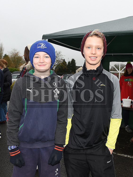 Luke Murphy and Nick Messpucher who took part in the Goal Mile at St Fechins GAA club on St Stephen's morning. Photo:Colin Bell/pressphotos.ie