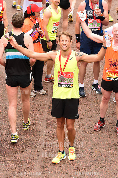 Jenson Button finishes the 2015 London Marathon, The Mall, London 26/04/2015 Picture by: Steve Vas / Featureflash