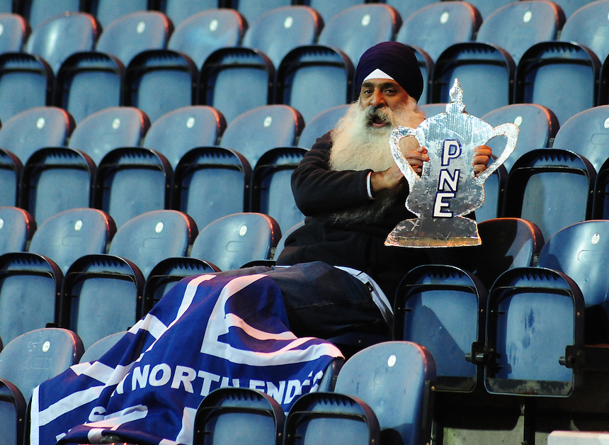 Preston North End fan Mr Roop Singh at the game<br /> <br /> Photographer Andrew Vaughan/CameraSport<br /> <br /> Football - FA Challenge Cup Second Round - Preston North End v Shrewsbury Town - Saturday 6th December 2014 - Deepdale - Preston<br /> <br />  &copy; CameraSport - 43 Linden Ave. Countesthorpe. Leicester. England. LE8 5PG - Tel: +44 (0) 116 277 4147 - admin@camerasport.com - www.camerasport.com
