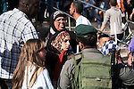 """Palestinian protesters argue with Israeli policemen during a demonstration marking the 66th anniversary of the """"Nakba,"""" meaning catastrophe, when many Palestinians fled or were expelled from their towns and villages during the war of Israel's foundation in 1948, at Damascus Gate in Jerusalem's Old City May 15, 2014. An Israeli police spokesman said on Thursday that 5 Palestinian protesters were detained during the unauthorized demonstration in Jerusalem's Old City, where stones were thrown at policemen and an Israeli flag was burnt. Also on Thursday, Israeli forces shot dead two Palestinians during a stone-throwing protest marking the """"Nakba"""" in the occupied West Bank. Photo by Saeed Qaq"""