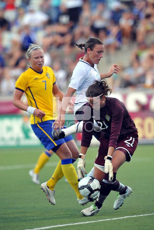 Sofia Lundgren gets to the ball before Abby Wambach...USWNT tied Sweden 1-1 at Morison Stadium, Nebraska.
