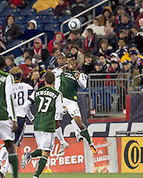 New England Revolution defender Didier Domi (3) and Portland Timbers midfielder Jeremy Hall (17) battle for head ball. In a Major League Soccer (MLS) match, the New England Revolution tied the Portland Timbers, 1-1, at Gillette Stadium on April 2, 2011.