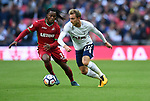 Christian Eriksen of Tottenham Hotspur is challenged by Renato Sanches of Swansea City during the premier league match at the Wembley Stadium, London. Picture date 16th September 2017. Picture credit should read: Robin Parker/Sportimage