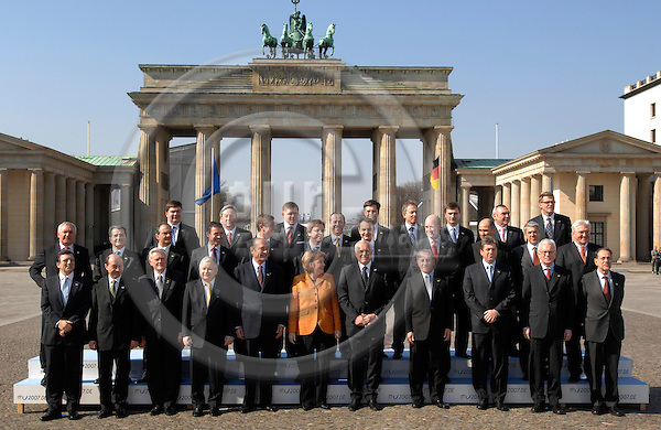 BERLIN - GERMANY 25. 3. 2007 -- The heads of state of the 27 European Union nations pose for a family photo around German Chancellor Angela Merkel (C), whose country currently holds the EU presidency, 25 March in front of Berlin's landmark Brandenburg Gate, at the end of weekend celebrations of the 50th anniversary of the Treaty of Rome which laid the foundation for the EU. Front row (LtoR) European Commission President Jose Manuel Barroso, Romania's President Traian Basescu, Lithuanian President Valdas Adamkus, Poland's President Lech Kaczynski, French President Jacques Chirac, German Chancellor Angela Merkel, Czech Republic President Vaclav Klaus, Cypriot President Tassos Papadopoulos, Bulgarian President Georgi Parvanov, the President of the European Parliament Hans-Gert Poettering, EU foreign policy chief Javier Solana. Middle row (LtoR): Ireland's Prime Minister Bertie Ahern, Italian Prime Minister Romano Prodi , Greek Prime Minister Kostas Karamanlis, Danish Prime Minister Anders Fogh Rasmussen, Hungarian Prime Minister Ferenc Gyurcsany, Belgian Prime Minister Guy Verhofstadt, Spanish Prime Minister Jose Luis Rodriguez Zapatero, Swedish Prime Minister Fredrik Reinfeldt, Slovenian Prime minister Janez Jansa, Portuguese Prime Minister Jose Socrates, German Foreign Minister Frank-Walter Steinmeier. Top row (LtoR) Latvian Prime Minister Aigars Kalvitis, Luxembourg's Prime Minister Jean-Claude Juncker, Slovakia's Prime Minister Robert Fico, Malta's Prime Minister Lawrence Gonzi, Dutch Prime Minister Jan Peter Balkenende, Britain's Prime Minister Tony Blair, Estonian Prime Minister Andrus Ansip, Austrian chancellor Alfred Gusenbauer, Finland's Prime Minister Matti Vanhanen. -- PHOTO: GORM K. GAARE / EUP- IMAGES .