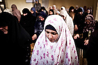 EGYPT, 6 of October city: Maha at the friday prayer among other Syrians and Egyptian women on the 21th February. <br /> <br /> Egypte, ville du 6 octobre: Maha &agrave; la pri&egrave;re du vendredi accompagn&eacute;es de syriennes et d'&eacute;gyptiennes.  21 f&eacute;vrier 2014.