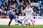 Lucas Vazquez (R) of Real Madrid battles for the ball with Manuel Alejandro Garcia Sanchez, Manu Garcia, of Deportivo Alaves during the La Liga 2017-18 match between Real Madrid and Deportivo Alaves at Santiago Bernabeu Stadium on February 24 2018 in Madrid, Spain. Photo by Diego Souto / Power Sport Images
