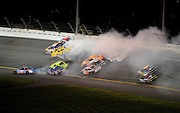 Jul. 5, 2008; Daytona Beach, FL, USA; NASCAR Sprint Cup Series drivers Terry Labonte (45) Sam Hornish Jr (77) J.J. Yeley (20) Johnny Sauter (70) Michael Waltrip (55) Travis Kvapil (28) Dave Blaney (22) and Reed Sorenson (41) are involved in a multi car accident on the last lap during the Coke Zero 400 at Daytona International Speedway. Mandatory Credit: Mark J. Rebilas-