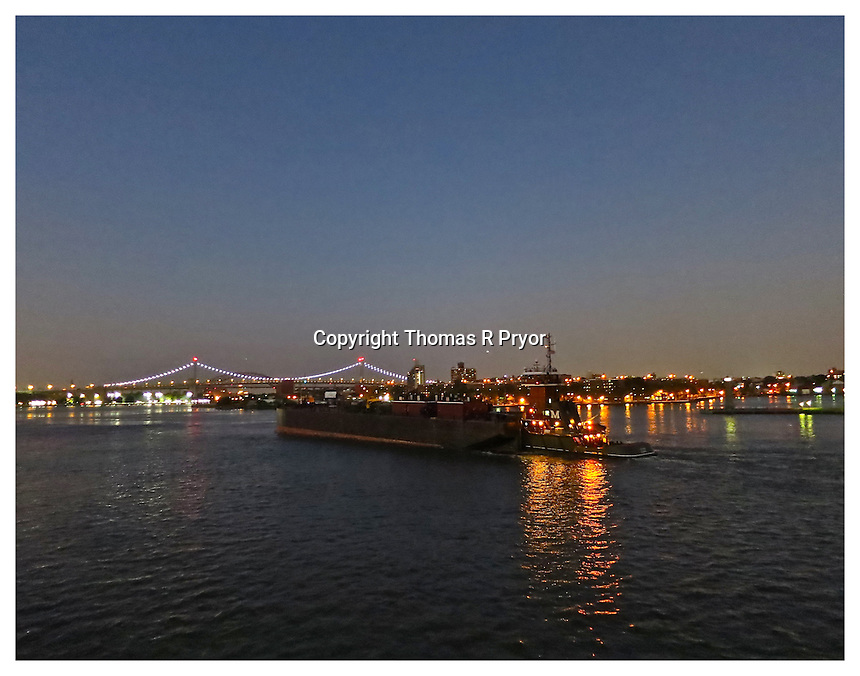 NEW YORK, NY - AUGUST 28: Tugboat in the East River as seen from Carl Schurz Park with the Triboro Bridge in the background in Yorkville, New York on August 28, 2012. Photo Credit: Thomas R Pryor