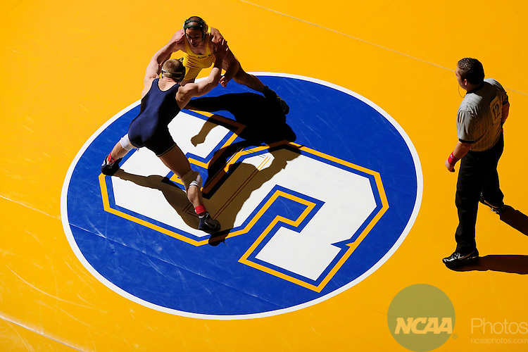 12 MAR 2011: Jesse Harrington of Delaware Valley takes on Elias Larson of Trine University in the 157 lbs quarterfinals during the Division III Men's Wrestling Championship held at the La Crosse Center in La Crosse Wisconsin. Stephen Nowland/NCAA Photos