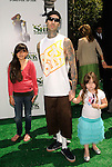 "UNIVERSAL CITY, CA. - May 16: Musician Travis Barker (2L) and his children (L-R) Landon Barker, Atiana de la Hoya and Alabama Barker arrive at the ""Shrek Forever After"" Los Angeles Premiere at Gibson Amphitheatre on May 16, 2010 in Universal City, California."