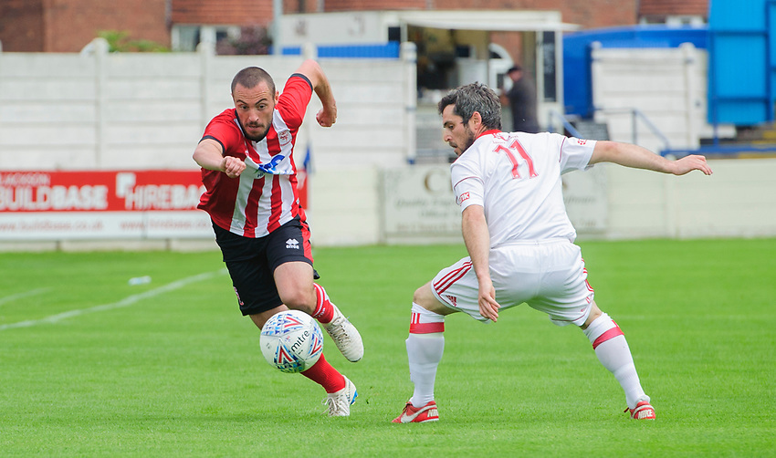 Lincoln City's trialist vies for possession with Lincoln United's Kallum Smith<br /> <br /> Photographer Chris Vaughan/CameraSport<br /> <br /> Football Pre-Season Friendly (Community Festival of Lincolnshire) - Lincoln City v Lincoln United - Saturday 6th July 2019 - The Martin & Co Arena - Gainsborough<br /> <br /> World Copyright © 2018 CameraSport. All rights reserved. 43 Linden Ave. Countesthorpe. Leicester. England. LE8 5PG - Tel: +44 (0) 116 277 4147 - admin@camerasport.com - www.camerasport.com