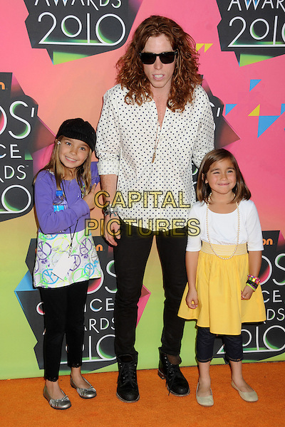 SHAUN WHITE & guests .at the 23rd Annual Nickelodeon Kids' Choice Awards 2010 held at Pauley Pavilion in Westwood, California, USA, March 27th 2010 .arrivals kids full length children girls black boots trousers  white and black polka dot shirt  blue sunglasses .CAP/ADM/BP.©Byron Purvis/Admedia/Capital Pictures