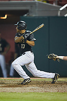 Anfernee Crompton (13) of the Army Black Knights follows through on his swing against the Auburn Tigers at Doak Field at Dail Park on June 2, 2018 in Raleigh, North Carolina. The Tigers defeated the Black Knights 12-1. (Brian Westerholt/Four Seam Images)