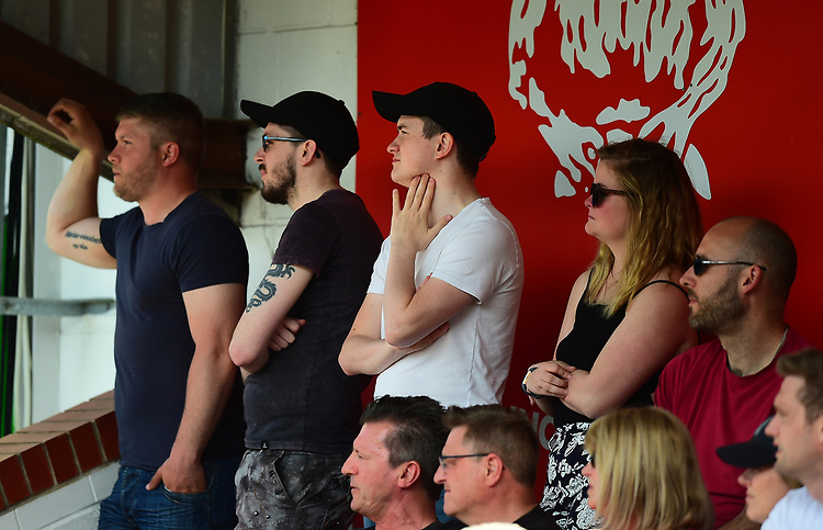 Lincoln City fans watch their team in action<br /> <br /> Photographer Andrew Vaughan/CameraSport<br /> <br /> The EFL Sky Bet League Two - Lincoln City v Tranmere Rovers - Monday 22nd April 2019 - Sincil Bank - Lincoln<br /> <br /> World Copyright © 2019 CameraSport. All rights reserved. 43 Linden Ave. Countesthorpe. Leicester. England. LE8 5PG - Tel: +44 (0) 116 277 4147 - admin@camerasport.com - www.camerasport.com