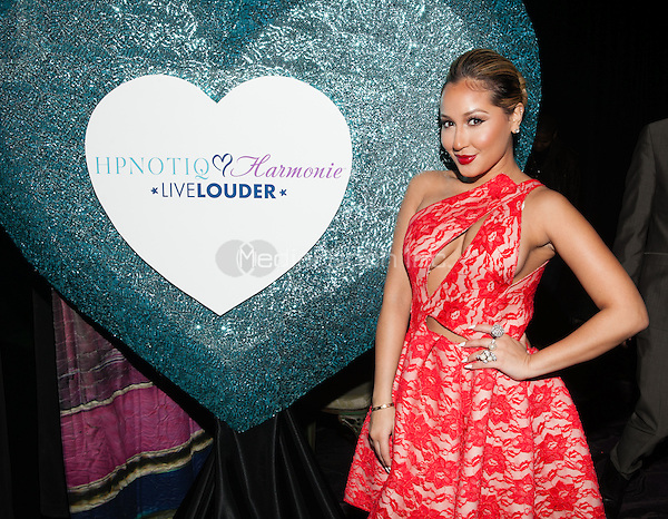 NEW YORK, NY - JANUARY 28: Adrienne Bailon celebrates the launch of her custom Valentine's Day cocktail recipe for HPNOTIQ liqueur on January 28, 2013 in New York City. © Diego Corredor/MediaPunch Inc.