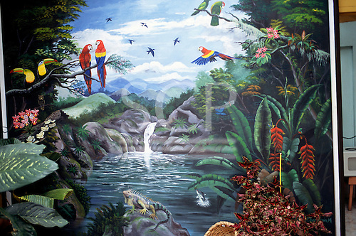 Sarchi, Costa Rica. Painting by artist Carlos Chaverri in his workshop; painting ox carts 70 years since he was 7.