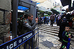 Palestinians walk past Israeli policemen as they stand guard in Jerusalem's old city following Friday prayers on November 6, 2015. The current wave of violence erupted in mid-September, fueled by rumors that Israel was trying to increase Jewish presence in Jerusalem then quickly spread across Israel, the West Bank and the Gaza Strip. Photo by Mahfouz Abu Turk