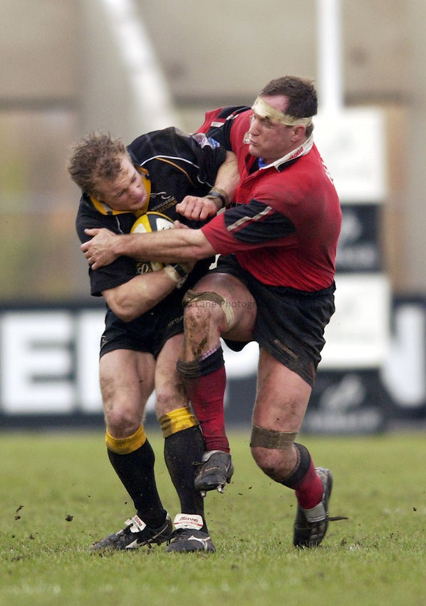 Photo. Jed Wee.Newcastle Falcons v Saracens, Parker Pen Challenge Cup, Kingston Park, Newcastle. 19/01/2003..Newcastle's Jamie Noon (L) with Saracens' Richard Hill.
