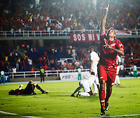 CALI -COLOMBIA-08-09-2013. Martín Arzuaga del América celebra un gol durante el partido entre América de Cali y Llaneros válido por la fecha 11 del Torneo Postobón II 2013 en el estadio Pacual Guerrero./ Martin Arzuaga of America celebrates a goal during the match between America de Cali and Llaneros valid for the 11th date of Postobon Tournament II 2013 at Pascual Guerrero stadium. Photo: VizzorImage/Juan C. Quintero/STR