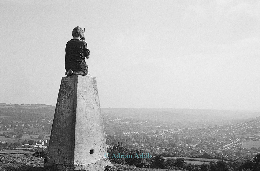 """on top of the hill. <br /> This local boy was overheard saying """"save the hill,  stop the road"""" into his radio handset"""