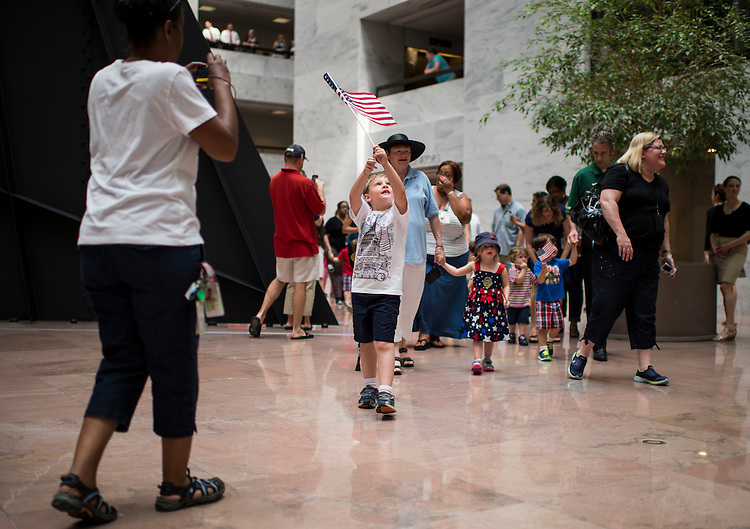 UNITED STATES - JUNE 28: Kids from the Senate Employees Child Care Center wave flags as they march around the Hart Senate Office Building atrium before the July 4th holiday recess on Friday, June 28, 2013. (Photo By Bill Clark/CQ Roll Call)