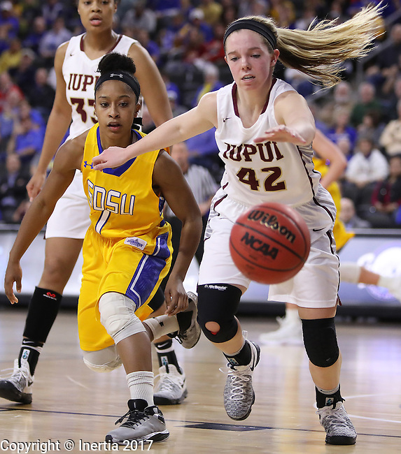 SIOUX FALLS, SD: MARCH 6: Sydney Hall #42 of IUPUI and Alexis Alexander #1 of South Dakota State chase a loose ball during the Summit League Basketball Championship on March 6, 2017 at the Denny Sanford Premier Center in Sioux Falls, SD. (Photo by Dick Carlson/Inertia)