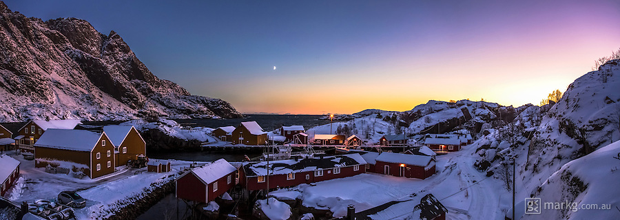 Nusfjord is a quaint village on the Lofoten Islands of Norway. It was 2.19pm during the seemingly endless twilight of the arctic winter, and the light was amazing! I had to climb an icy ladder up a tower to get this shot and it was totally worth it!