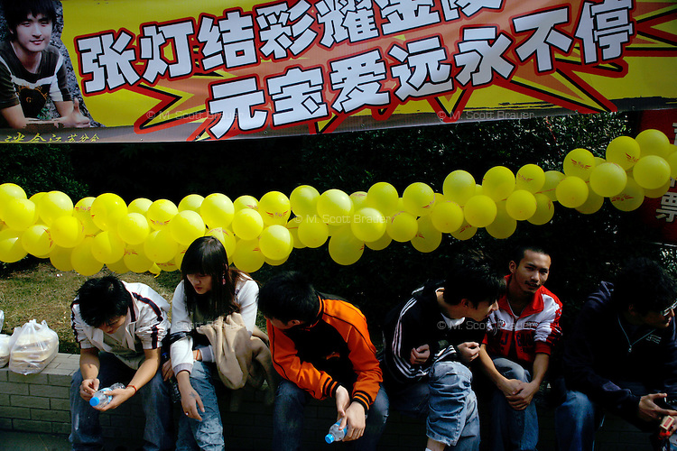 Fans display pictures and balloons in support of their favorite pop music singers competing in a local Superboy competition in Nanjing, Jiangsu, China.  Superboy singing competitions are similar to Pop Idol or American Idol singing competitions in the US and UK.