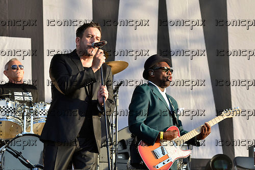 THE SPECIALS - L-R: John Bradbury, Terry Hall, Lynval Golding - performing live at the BT London Live 2012 Olympic Concerts in Hyde Park London UK -12 Aug 2012.  Photo credit: George Chin/IconicPix