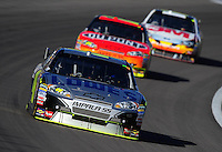 Mar. 1, 2009; Las Vegas, NV, USA; NASCAR Sprint Cup Series driver Jimmie Johnson leads teammate Jeff Gordon and Greg Biffle during the Shelby 427 at Las Vegas Motor Speedway. Mandatory Credit: Mark J. Rebilas-