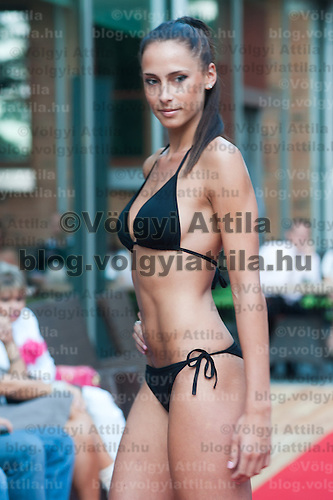 Patricia Firts a participant of the Beauty Queen contest attends a bikini tour in Hotel Abacus, Herceghalom, Hungary on July 07, 2011. ATTILA VOLGYI