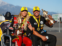 Feb 12, 2017; Pomona, CA, USA; NHRA top fuel driver Leah Pritchett celebrates with funny car teammate Matt Hagan after winning the Winternationals at Auto Club Raceway at Pomona. Mandatory Credit: Mark J. Rebilas-USA TODAY Sports