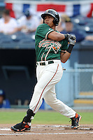 Greensboro Grasshoppers center fielder Jesus Solorzano #12 swings at a pitch during game one of a double header against the Asheville Tourists on July 2, 2013 in Asheville, North Carolina.  The Tourists won the game 5-3. (Tony Farlow/Four Seam Images)