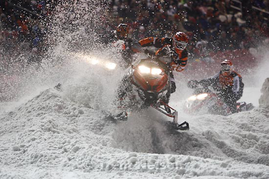 Trent Nelson  |  The Salt Lake Tribune.Racers throw up snow coming through the corner during the Western Nationals of the AMSOIL Championship Snocross Series at Rio Tinto Stadium in Sandy, Saturday, January 9, 2010.