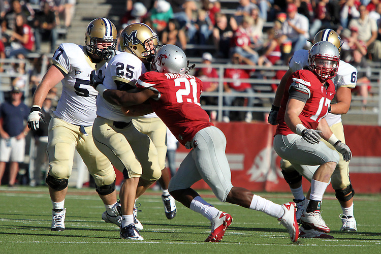 Washington State senior defensive back, Chima Nwachukwu (#21), makes the tackle on Bobcat running back, Cody Kirk, during the Cougars 23-22 comeback victory over Montana State at Martin Stadium on the WSU campus on September 11, 2010.