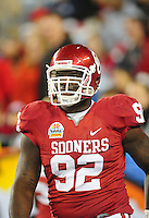 Jan. 1, 2011; Glendale, AZ, USA; Oklahoma Sooners defensive tackle (92) Stacy McGee against the Connecticut Huskies in the 2011 Fiesta Bowl at University of Phoenix Stadium. The Sooners defeated the Huskies 48-20. Mandatory Credit: Mark J. Rebilas-.