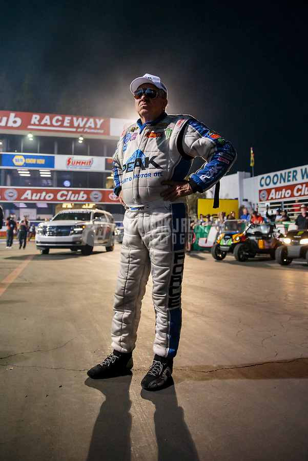 Nov 9, 2018; Pomona, CA, USA; NHRA funny car driver John Force during qualifying for the Auto Club Finals at Auto Club Raceway. Mandatory Credit: Mark J. Rebilas-USA TODAY Sports