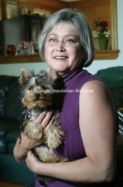 WATERTOWN, CT 30 June 2005 -063005BZ02- Rhonda Morgan, of Oakville, poses with her dog &quot;Lucy&quot; in the living room of her home Thursday afternoon.  <br /> Jamison C. Bazinet Photo