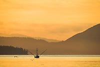 Commercial fishing trolling vessel in the Sitka Channel, Baranof Island, southeast Alaska.