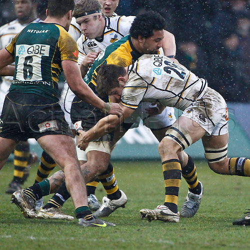 04.02.2012.  Northampton, England. Samu MANOA of Northampton Saints is tackled by Sam JONES of London Wasps during the LV= Cup match between Northampton Saints and London Wasps at Franklin's Gardens.