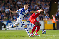 Amari'i Bell of Fleetwood Town shields the ball from Ollie Clarke of Bristol Rovers during the Sky Bet League 1 match between Bristol Rovers and Fleetwood Town at the Memorial Stadium, Bristol, England on 26 August 2017. Photo by Mark  Hawkins.