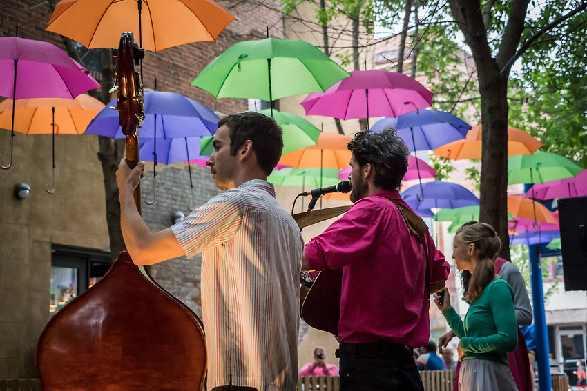 Musician Mike Waite and crew entertain during Art Week in downtown Marquette, Michigan.