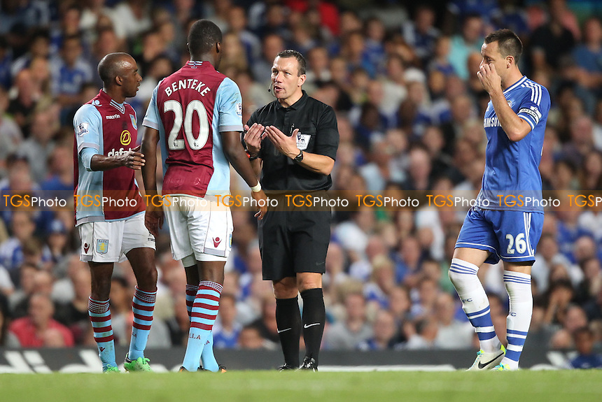 Kevin Friend Lectures Christian Benteke of Aston Villa - Chelsea vs Aston Villa - Barclays Premier League Football at Stamford Bridge, Fulham Road, London - 21/08/13 - MANDATORY CREDIT: Simon Roe/TGSPHOTO - Self billing applies where appropriate - 0845 094 6026 - contact@tgsphoto.co.uk - NO UNPAID USE