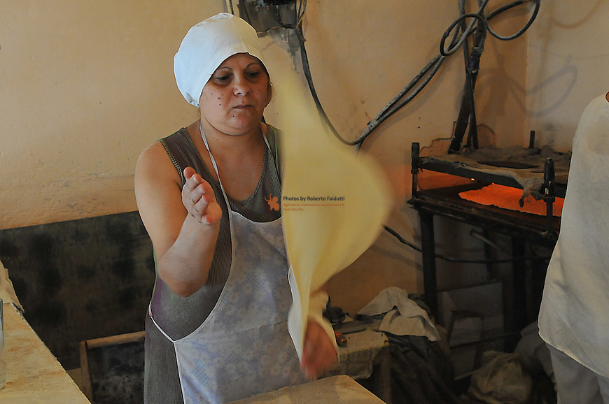 "Women cooking traditional armenian bread ""Yavash"""