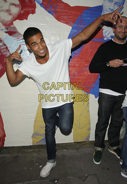Lucien Laviscount.The Puma Yard - Professor Green special performance, The Boiler House, Old Truman Brewery, Brick Lane, London, England..August 11th, 2012.full length white t-shirt jeans denim hands arms posing leg foot up.CAP/CAN.©Can Nguyen/Capital Pictures.