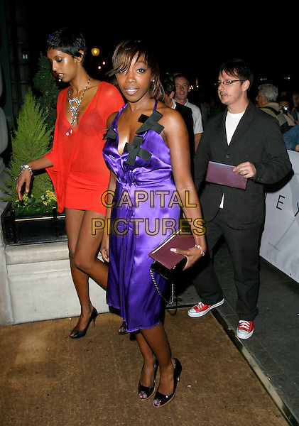 ESTELLE.At the Next Models London Fashion Week Party,.Cafe Royal, London, England, September 19th 2006..full length purple satin silk dress black bows.Ref: AH.www.capitalpictures.com.sales@capitalpictures.com.©Adam Houghton/Capital Pictures.