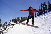 Snowboarder jump, Mt. Baker, Cascade Range, Washingto