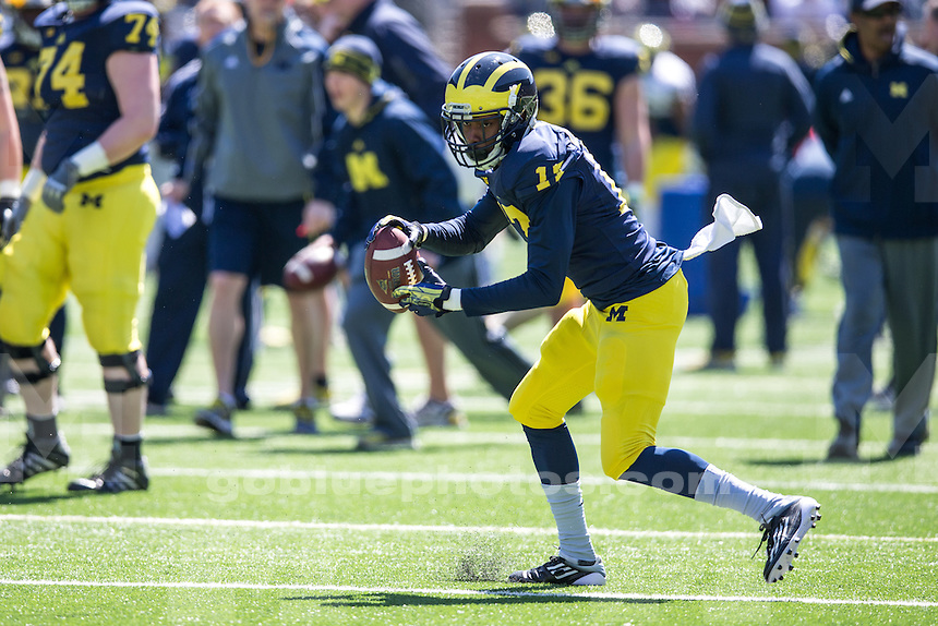 The University of Michigan football team participates in the annual 'Spring Game' at Michigan Stadium in Ann Arbor, Mich. on April 4, 2014.