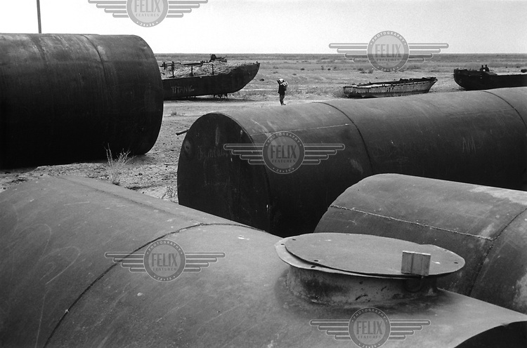 Abandoned ships at what was once the edge of the Aral Sea. In 1964 the rivers supplying the Aral were pumped dry to irrigate crops. After that autumn the tide never returned. Nowadays the water has receded over 100 kilometres from Muynak.
