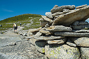 Hikers ascend South Baldface Mountain using Baldface Circle Trail in the White Mountains of New Hampshire USA during the spring months.